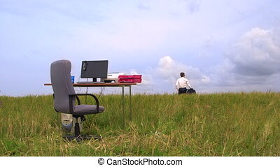 Business person teleworking - Personal computer on a desk in...
