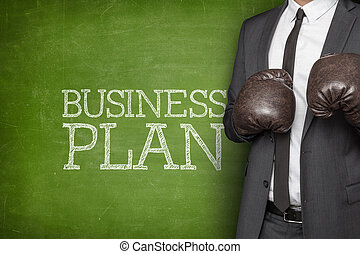 Business plan on blackboard with businessman