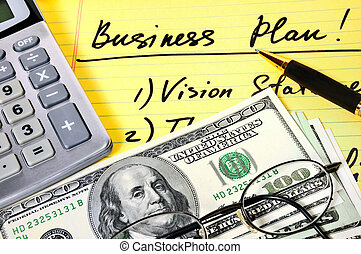 Business plan with money, calculator and pen.
