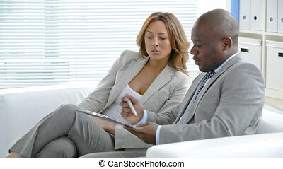 Business partners discussing their future financial plans in office