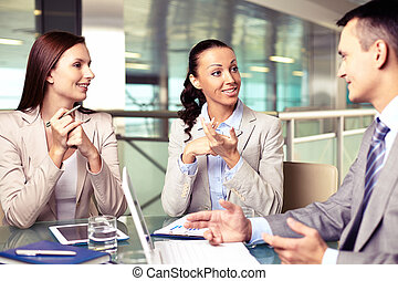 Business points - Confident businesswomen looking at their ...