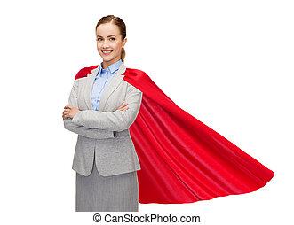 young smiling businesswoman in red superhero cape - business...