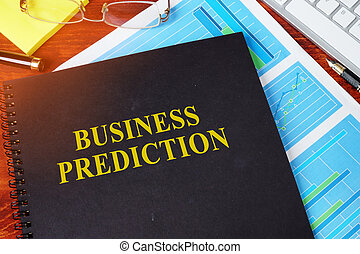 Business Prediction concept. Book and financial charts.