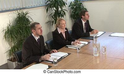 Business Presentation - Stock Footage - Three executives...