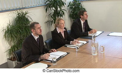 Business Presentation - Stock Footage - Three executives...