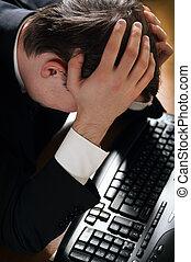 Business problem - Depressed business man sitting at...