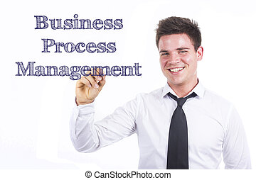 Business Process Management BPM - Young smiling businessman writing on transparent surface