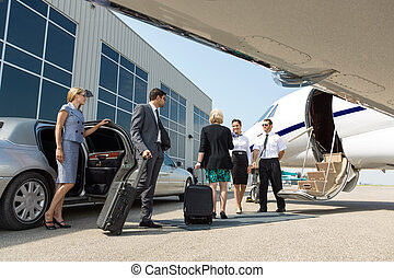 Business Professional About To Board Private Jet - Business...