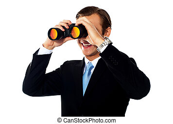 Business professional looking through binoculars