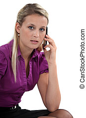 Business professional talking on her mobile phone