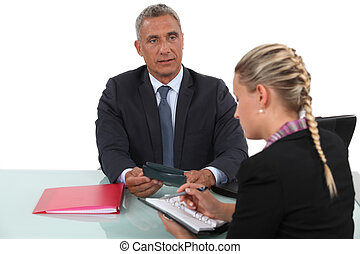 Business professionals arranging a meeting time