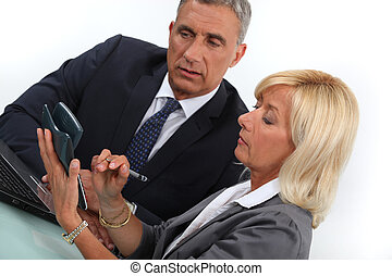 Business professionals calculating costs
