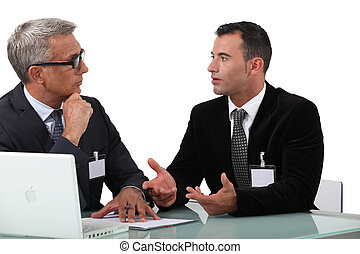 Business professionals having a discussion