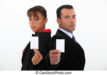 Business professionals holding their business cards