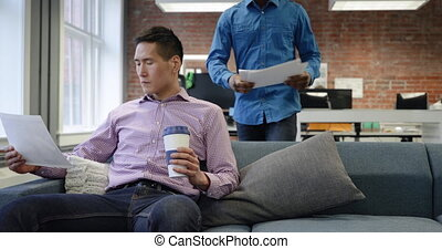 Business professionals working in a modern office