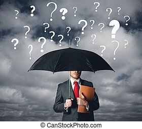 A businbessman protects himself by doubts with umbrella