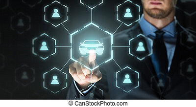 businessman with virtual hologram of car sharing