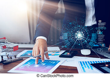 Business report, analysis and planning, Businessman hand pointing at business document and a tablet, mobile phone displaying financial data with icon network connection background.