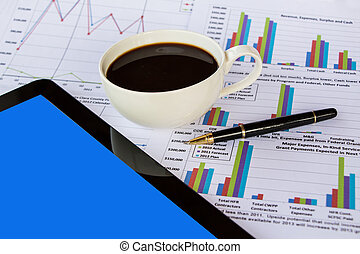 Business report and coffee cup