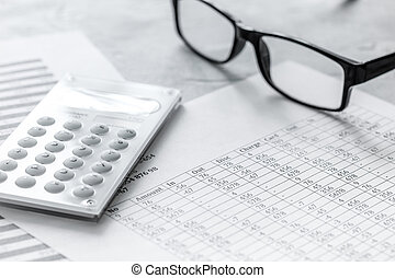 Business report preparing with calculator and glasses on office background