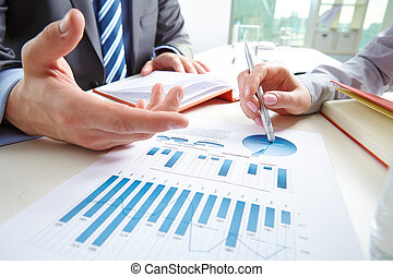 Business review - Businessman pointing at document while...