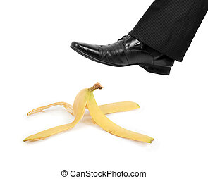 Business risk concept: boot to step on a banana skin
