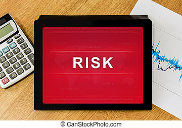 business risk word on digital tablet