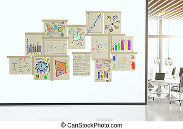 Business scheme concept on paper posters on white wall in conference room