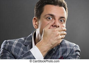 Business secret - Portrait of afraid businessman wearing...