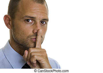 Business Secrets - Business man with his finger on his lips