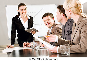Business seminar - Portrait of business people discussing a...