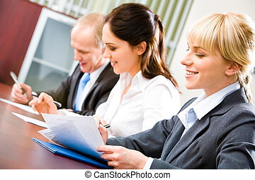 Business seminar - Image of confident students sitting at...