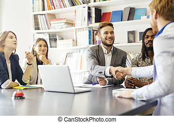 Business shaking hand with a client