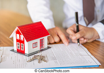 Business Signing a Contract Buy - sell house, Home for rent concept, broker agent presenting and consult detail to customer to making the decision a home estate loan to customer sign form agreement.