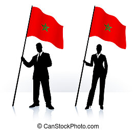 Business silhouettes with waving flag of Morocco