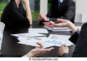 Business situation - Four business people at a meeting