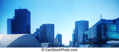 Business skyscrapers panorama in blue tint. Paris, France -...