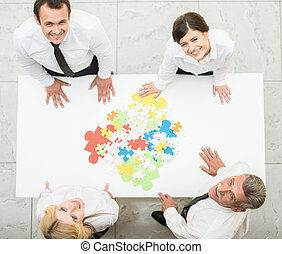 Business solutions - Image of confident business people...