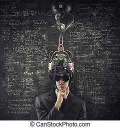 Business solutions: man wearing a brain-control helmet.