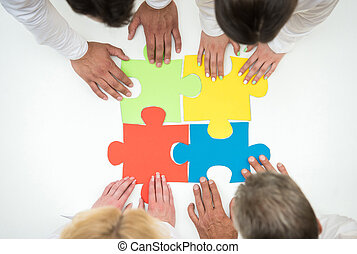 Business solutions - Group of business people assembling...