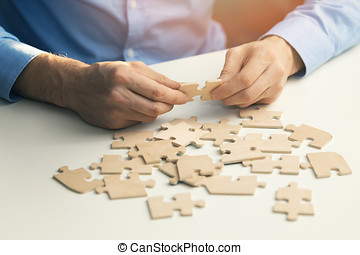 business solutions success and strategy concept. businessman with jigsaw puzzle
