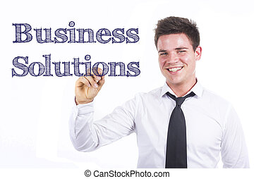 Business Solutions - Young smiling businessman writing on transparent surface