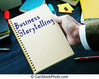 Business storytelling handwritten phrase on the page.
