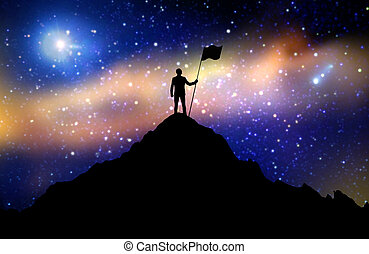 silhouette of businessman with flag on mountain