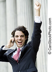 Business Success - A young man celebrating business success...