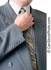Business suit - Man in grey business suit straightening his...