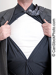 Business superhero - A business man tears open his shirt in...
