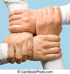 Photo of business people�s hands touching each other