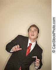 Business Surprise - Business man in white shirt, black suit,...