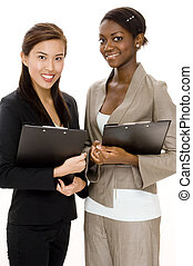 Business Survey - Two attractive young business women with...